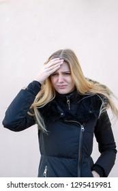 Woman in winter with headache