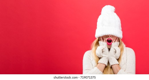 Woman with a winter knit hat pulled over her eyes