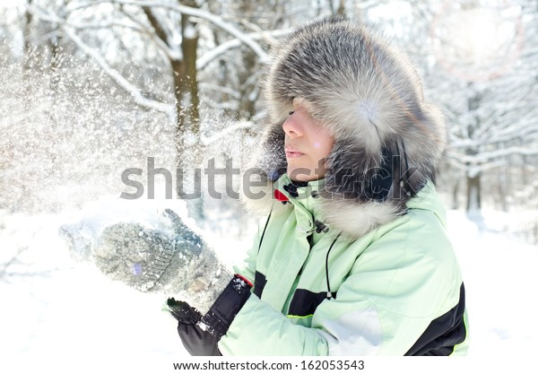 woman in winter with magic snow breathe