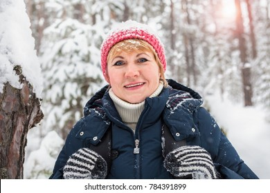 A woman in the winter. Senior woman in the park and in forest.