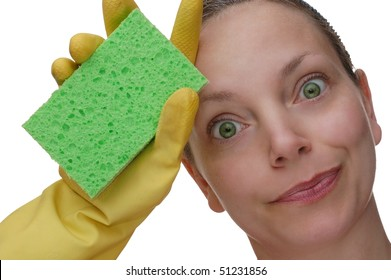 Woman Wiping Brow Expressively After Cleaning with a Sponge