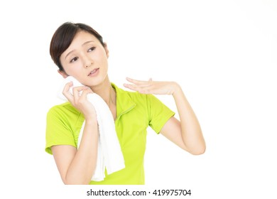 Woman wiping off the sweat
