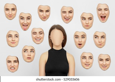 Woman Without a Face. On the walls hang the face masks. Nobody. A set of masks with different emotions