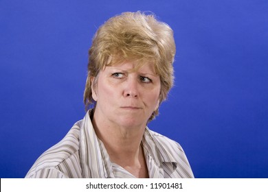 woman wondering about something on a blue background