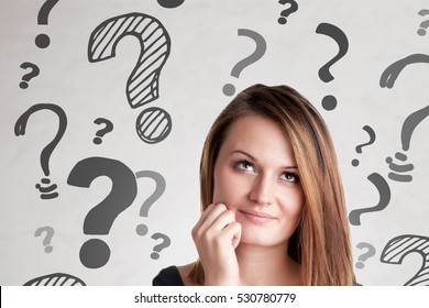 Woman wondering, with question marks around her