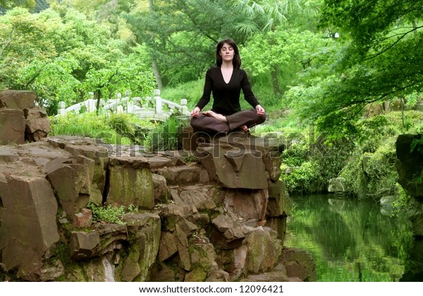 a woman in a wood in yoga position