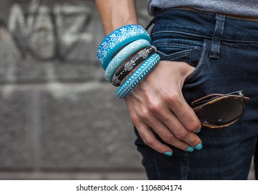 Woman with wooden blue wooden jewelry and sunglasses, fashion concept