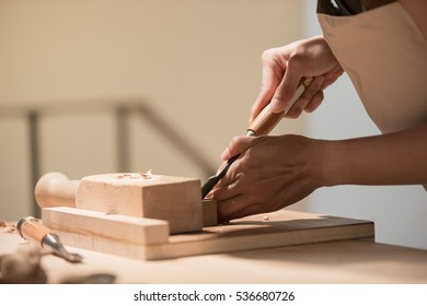 woman woodworking look and smile happily ,asian