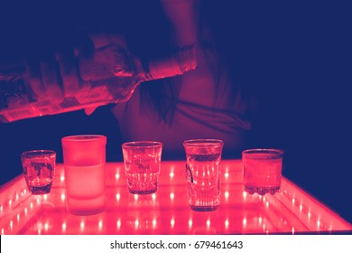 woman work as a barmen in a club