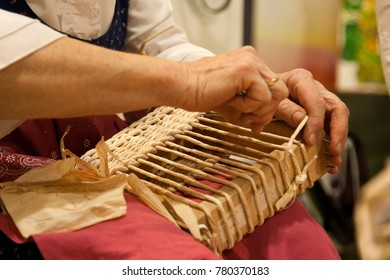 Woman at work. Woman is doing a basket with vimini - Shutterstock ID 780370183