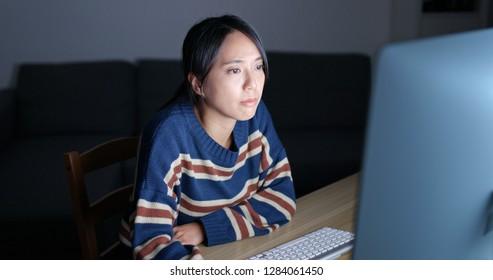 Woman work on computer at night
