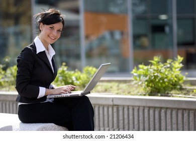 woman work outdoors with a laptop