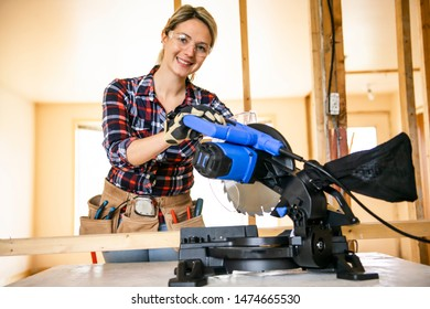 A woman worker in the carpenter workroom renovation with Sliding Mitre Saw