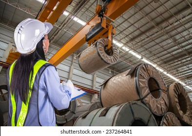 The woman worker report and loading in warehouse