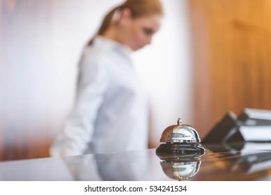 Woman working behind reception desk