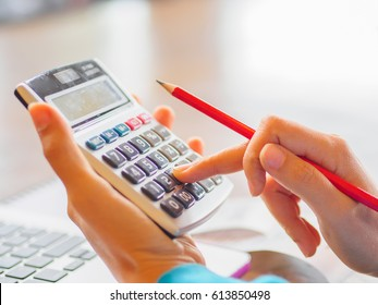 woman working with calculator, business document and laptop computer notebook