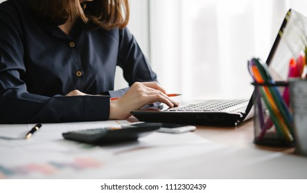 Woman working at computer hands close up
