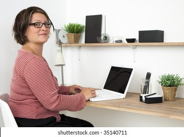 Woman working in a cozy workspace at home