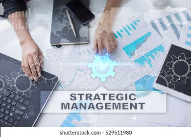Woman is working with documents, tablet pc and notebook and selecting strategic management.