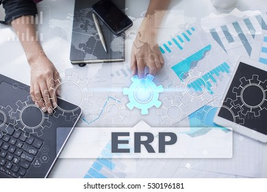 Woman is working with documents, tablet pc and notebook and selecting erp.