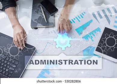 Woman is working with documents, tablet pc and notebook and selecting administration.
