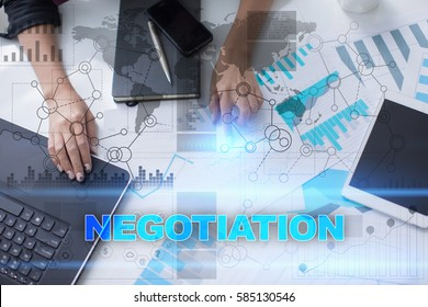 Woman working with documents, tablet pc and notebook and selecting negotiation.