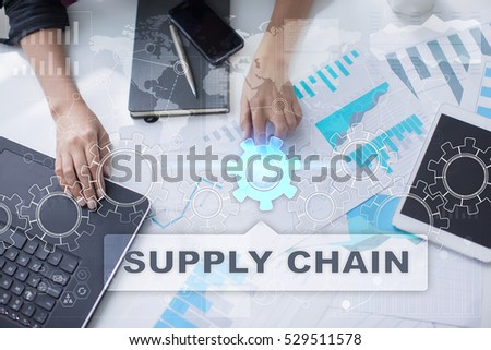 Woman is working with documents, tablet pc and notebook and selecting supply chain.