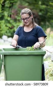 Woman working in her garden preparing for autumn