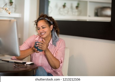 Woman working in her home office.