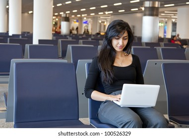 Woman working with her notebook in the airport