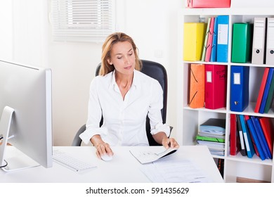 Woman working at her office
