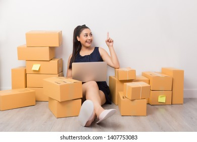 woman working at home office packaging on background