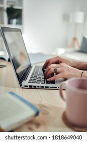 Woman working from home, using laptop / notebook, modern freelance concept.