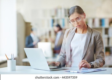 Woman working with laptop in office