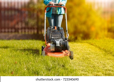woman working with a lawnmower