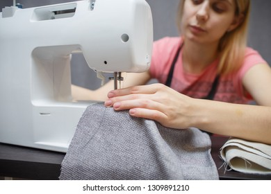 Woman working with the machine for sewing. Sewing Process