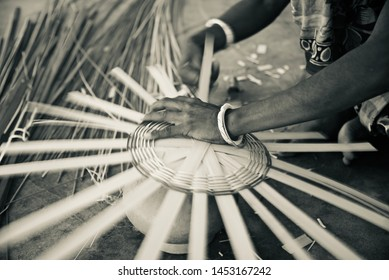 Woman working to make a bamboo made showpiece object