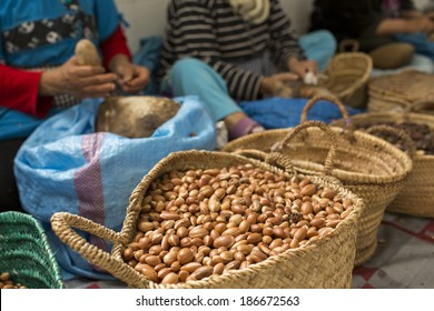 Woman working on argan oil factory in Morocco