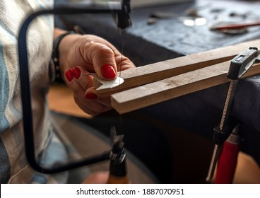 woman working on a bench in a jewelry manufacturing workshop - Shutterstock ID 1887070951