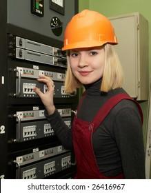 woman working on breaker panel