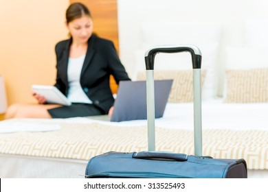 woman working on a business trip at the hotel
