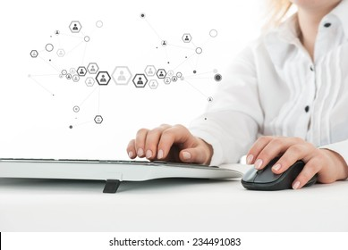 Woman working on computer with added graphic global human connection icon
