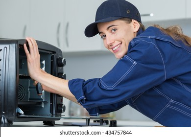 Woman working on counter top oven