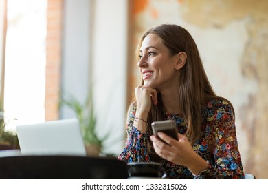 Woman working on her laptop at cafe
