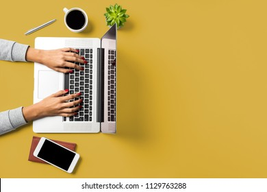 Woman working on laptop. Business background