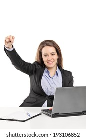 Woman working on laptop and gesturing success isolated on white background