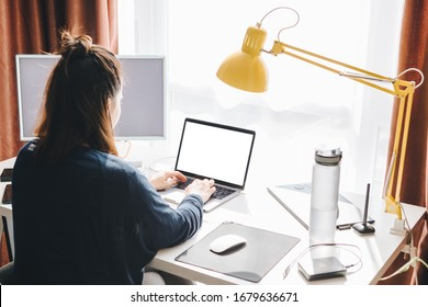 woman working on laptop at home. telework
