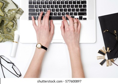 Woman is working on laptop. Workplace. Fashion blog. Flat lay concept photo