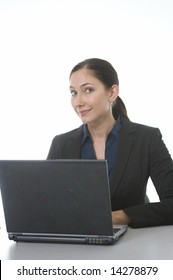 woman working on notebook computer in office