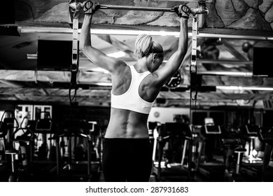 Woman working out back exercises. pull ups.